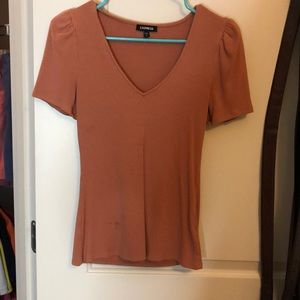 V-neck peach colored blouse